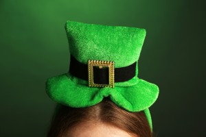 St. Patricks hat on head on green background