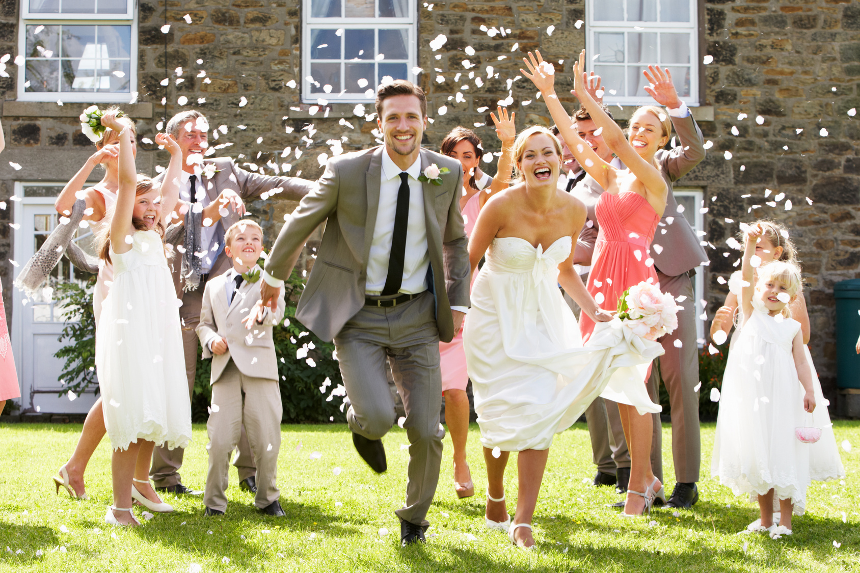 Guests Throwing Confetti Over Bride And Groom Wedding Insurance Coverage