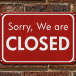 "sign that reads ""Sorry, We are Closed"""