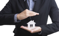 agent protecting home cutout with hands