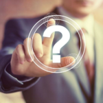 man in suit touching question mark icon