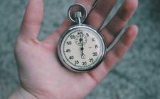 person holding a stop watch