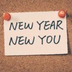 sign that says new year new you
